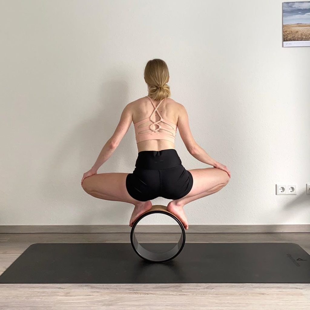 stand on yoga wheel